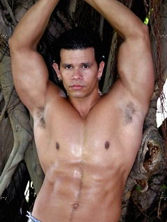 Gorgeous Latin gay guy shows off his hot abs and strong arms outdoors