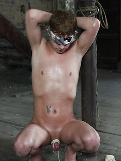Teen twink is bound and blindfolded in the dungeon for his punishment