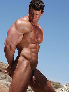 Hunk with incredible muscles poses in the desert and shows off his perfect body