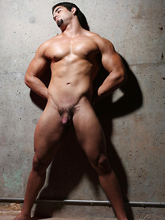 Strong stud take off the clothes and starts posing sexy against the wall