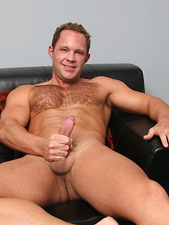 Hairy chest hunk finishes stripping and grabs hold of his dick to jerk it off solo