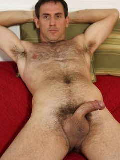 Hairy mature dude drops down his jeans in order to unveil his erect member