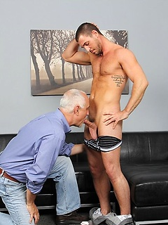 Horny gay daddy Jake Cruise gives this young hunk with a hard body the best blowjob