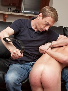 Daddy gives the misbehaving twink a hard paddling and belting on his tight ass