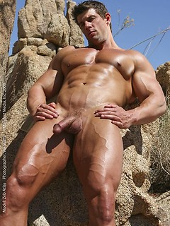 Strong stud Zeb Atlas likes to pose naked outdoors while he plays with his dick