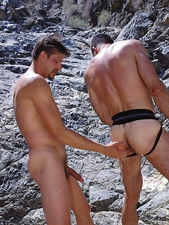 Two horny stallions simply adore banging each other in the scorching sun