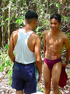 Cute Latin guys strip naked in the jungle and have anal sex until they cum