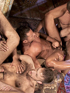 Group of gay dudes takes turns at playing with each other's stiff dicks