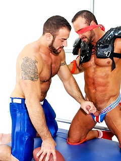 Football hunk bound and blindfolded to be fondled by his sexy bear master