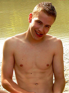 Play by the river with a charming twink boy as he strips and models his smooth body
