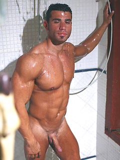 Body building hottie Gustavo Levu poses in the jungle and shows off his cock in the shower