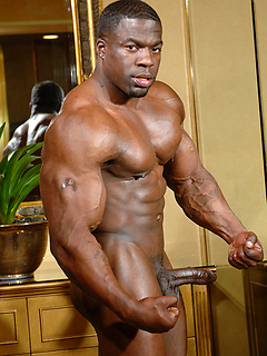 Thickly ripped black body builder Chuck Basher is naked and rock hard