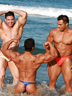 Gorgeous body builders pose in paradise and show off bodies that are fantastically sexy