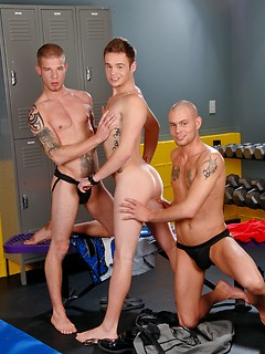 Tattooed gay hotties in the locker room have a lusty threesome with good fucking