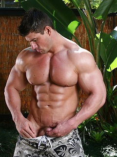 Body builder is big and sexy as he strips and plays with a surprisingly large cock