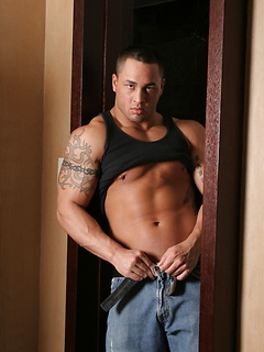 Muscular hunk slowly lifts his tank top and takes off his jeans to get fully naked