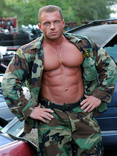 Body builder shows off his sexy army fatigues and his incredible flexed muscles