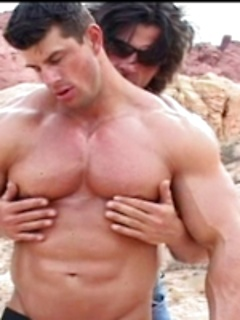 Beefy guys in the desert undress each other and caress their hard pecs