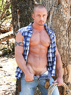See the cowboy hunk flex as he strips on the ranch and his big dick gets hard
