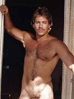 Vintage solo gay pictures with a hunky guy baring his hairy chest and mustache