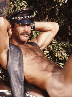 Sexy retro gay guy with a mustache and rock hard body poses in black and white