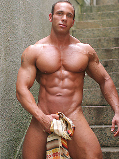Flexing body builder Vinnie de Angelo models his hard body and big cock outdoors
