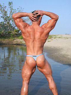 Latin hunk plays in the river and on the beach while flexing his big sexy muscles