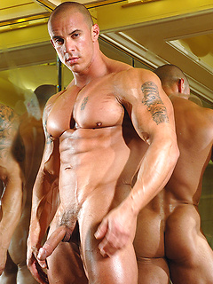 Hunky Vin Marco models his muscular body and growing cock for his fans