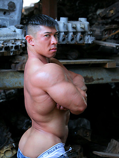 Incredibly handsome Asian dude shows off his huge muscles in the workshop