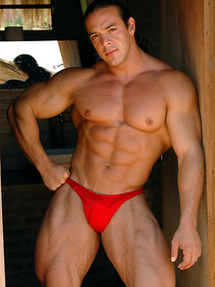 Muscular stallion poses in speedos and makes his hard shaft explode with cum