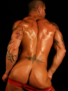 Tattooed muscle stud Luis flexes and poses while teasing his amazingly tight ass