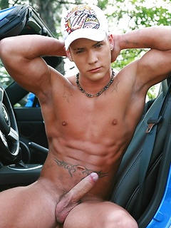 Tattooed boy gets naked outdoors pretty fast so he can pose on the car