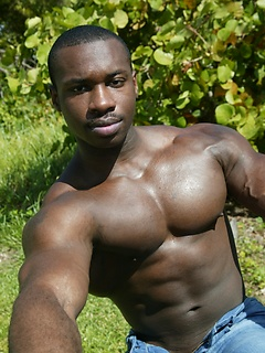 Black muscle stud poses in a tight tank top and shows off the big cock you crave