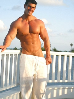 Handsome Zeb Atlas slowly takes off the clothes while posing on the balcony