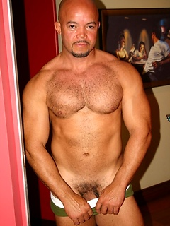 Stunning bald Latino hunk flexes his muscles and teases with his fat meat pole