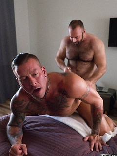 Two muscular dudes Brad and Hugh get around to pleasuring their hard dicks