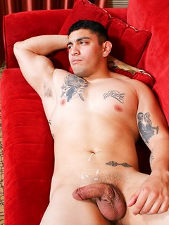 Kinky guy with tattoos finally gets to jerk his dick on the couch until he cums