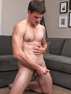 Naked all-American guy Emerson models his tight body and hard cock in close up