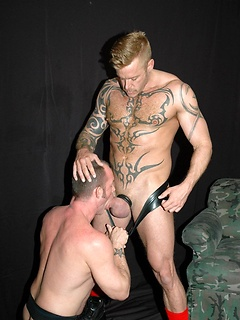 Jockstrap top gets his dick sucked and delivers a fist fucking to that tight ass