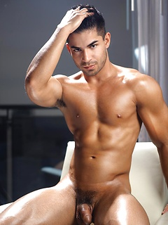 Handsome guy Nicco Sky slowly takes off the clothes and poses on the chair