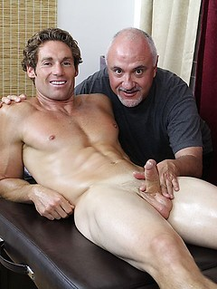 Gorgeous hunk on the massage table for a naughty gay rubdown from an old guy