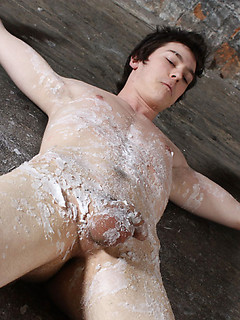 Bound and smooth submissive gay boy completely covered in hot wax by his master
