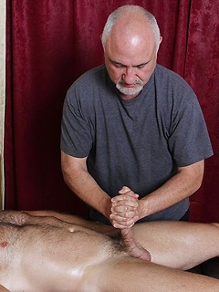 Gay daddy gives a handjob on the massage table and licks that sexy ass