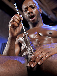 Gorgeous solo black gay model slides a sounding rod down his rock hard cock