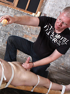 Bound and punished young man enjoys the pain of hot wax on his cock