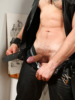 Leather-clad stallion Jedd whips out his pecker and uses a toy to make it cum