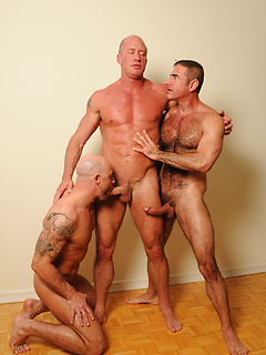 Three studs with big cocks and hard bodies have a great anal threesome with sucking