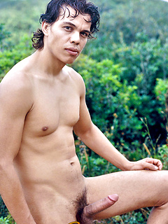Thick lips Latino takes his clothes off in a field and lets his sexy cock hang free