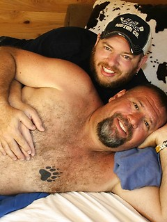 Two fat and hairy guys play around with each other's throbbing meat poles