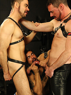 Gay leather threesome in the dungeon ends with a dirty double penetration